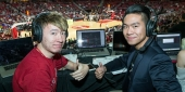 James and Javi Yuan broadcasting in the press box in the Liacouras Center.