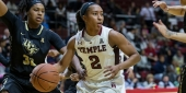 A Temple women's basketball player dribbling the basketball.