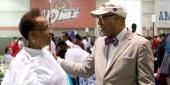 Michael Robinson talks with a woman at the Neighborhood Job Fair