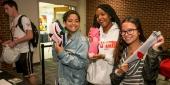 students bringing socks to be donated during SOCKtober Fest