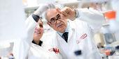 Kamel Khalili and researcher in lab