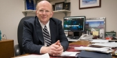 Assistant Vice President and Bursar David Glezerman sitting at his desk
