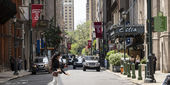 A young woman crosses the street in Center City.