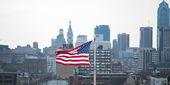 American flag against Philadelphia skyline