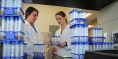 Engineering researchers handling test tubes in a lab.