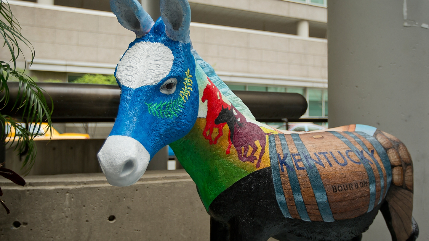 A donkey painted with visual elements representing Kentucky.