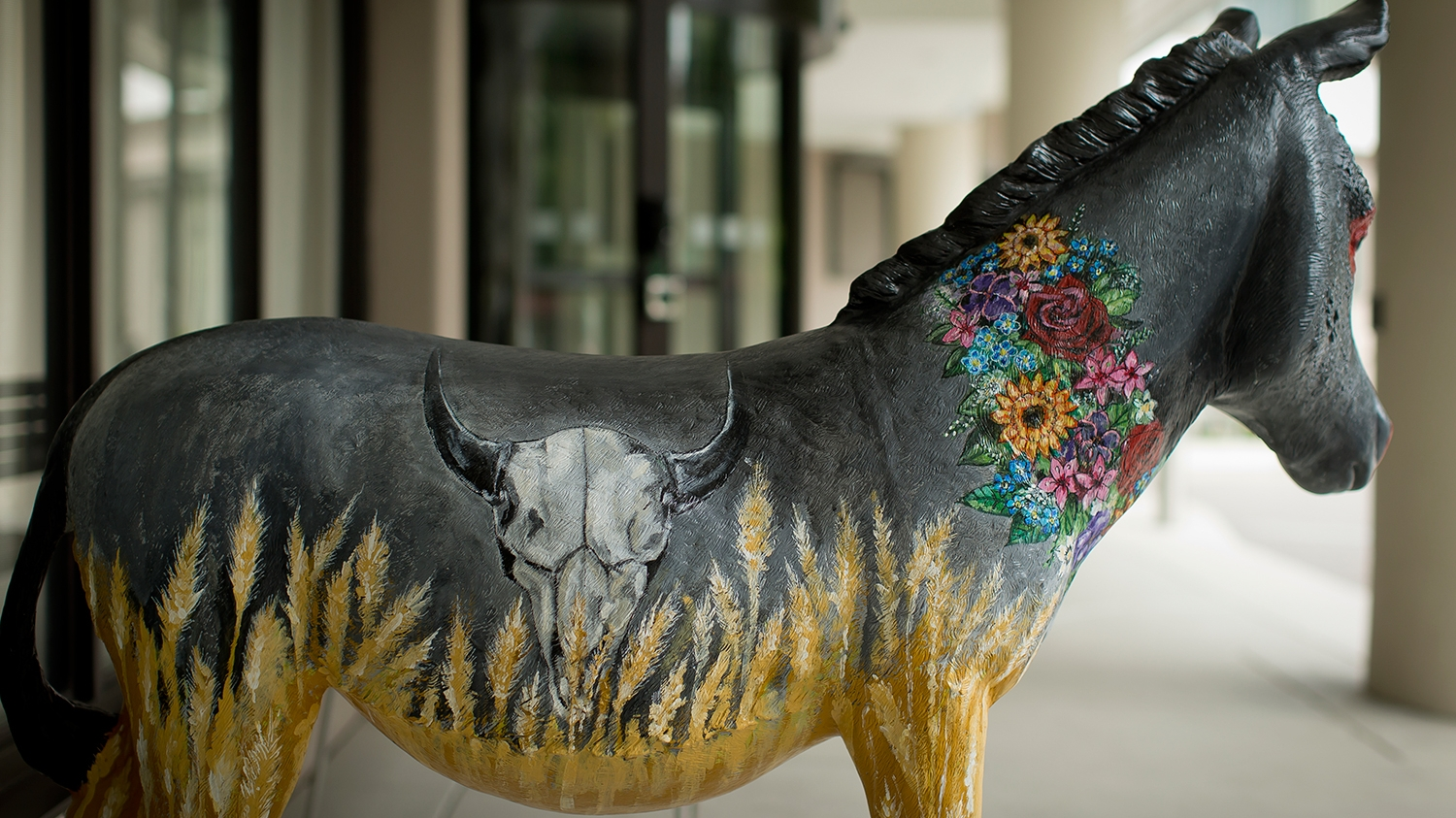 A donkey painted with visual elements representing North Dakota.