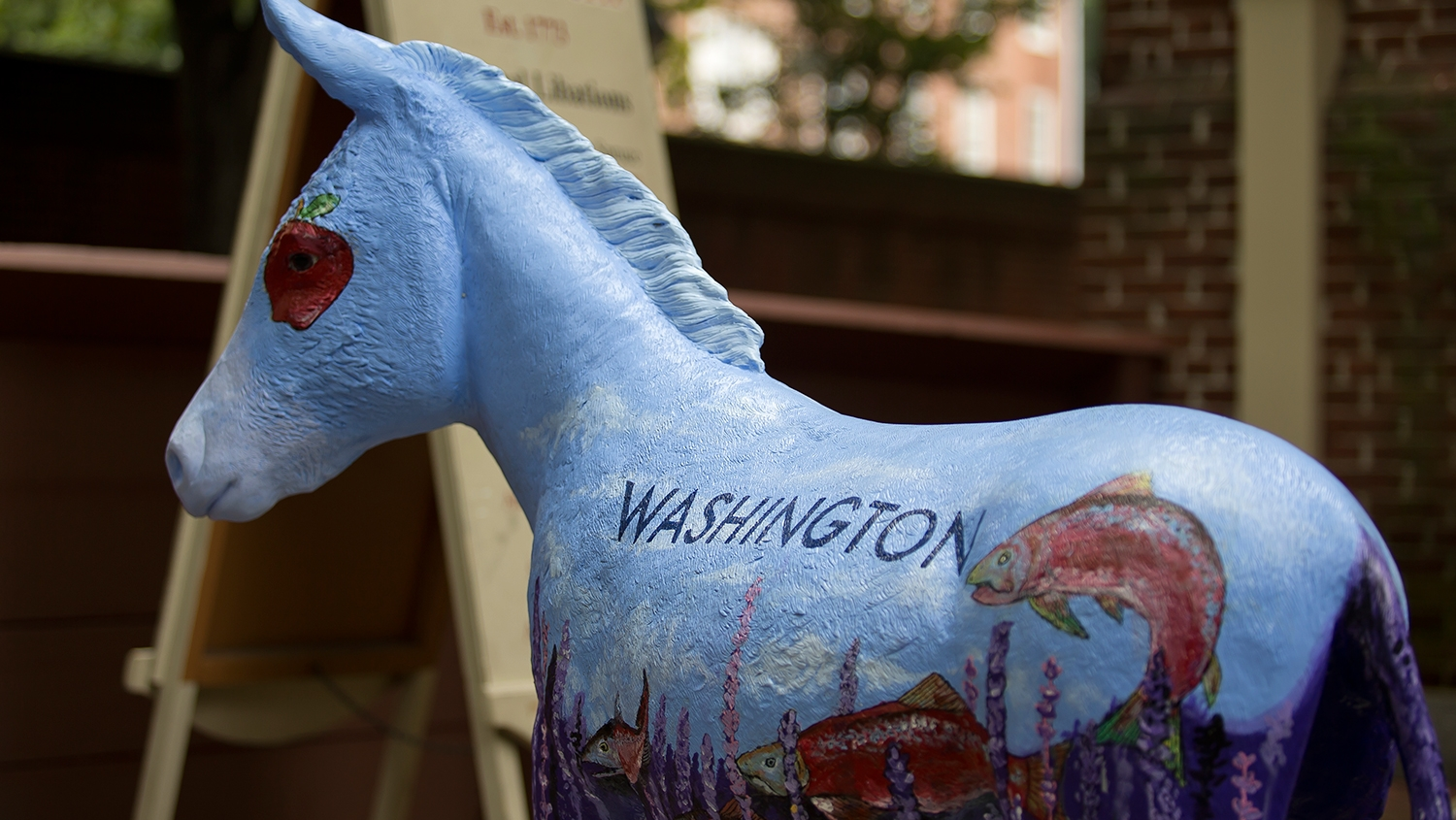 A donkey painted with visual elements representing Washington.