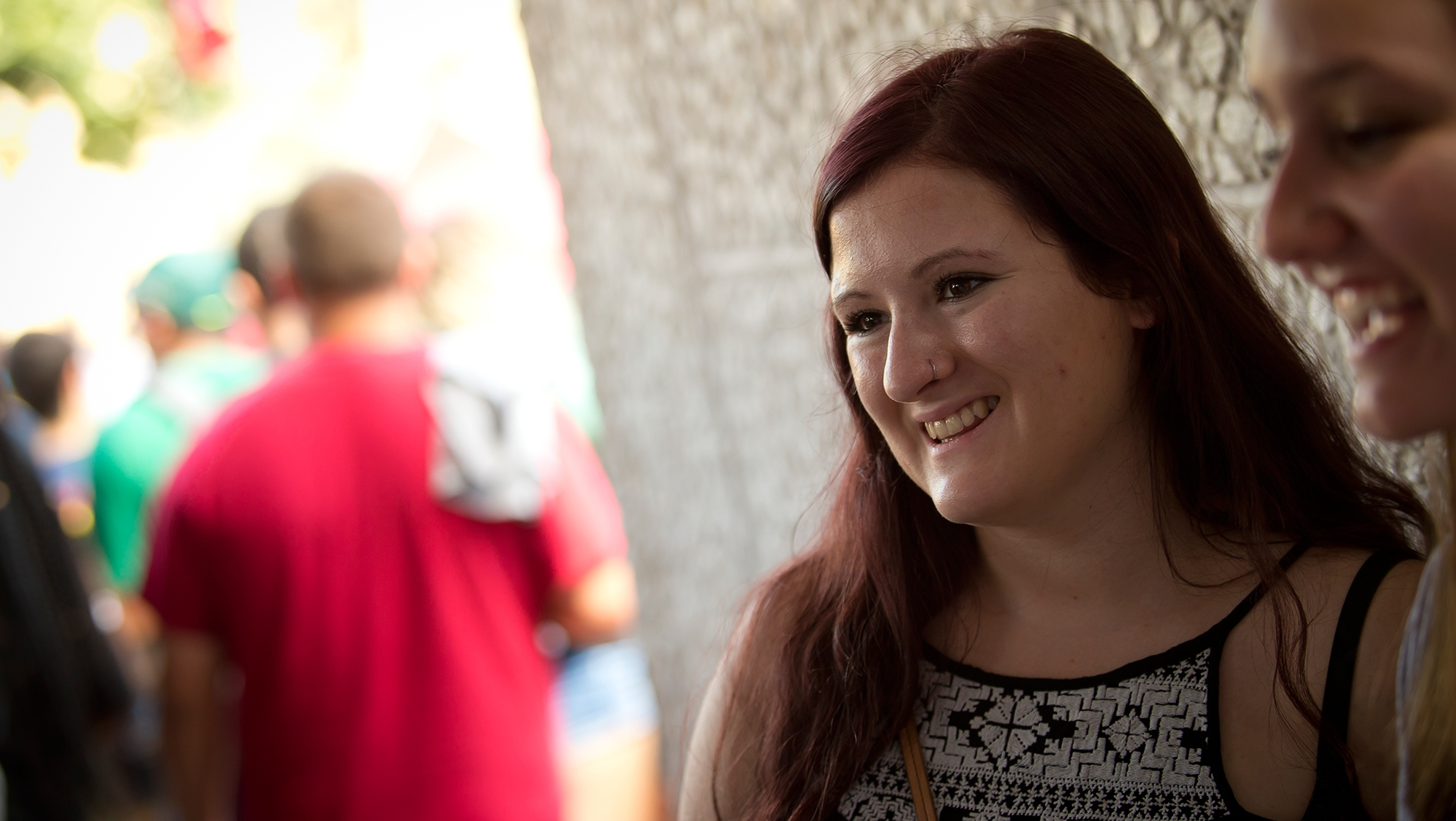 A woman smiling at the new student BBQ on Temple's Main Campus.