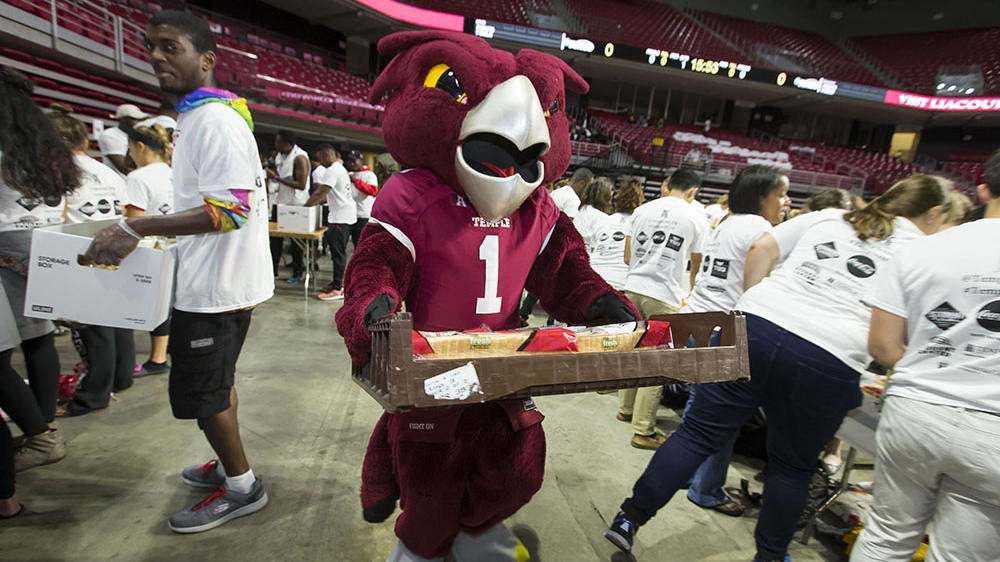 Hooter carrying a tray of bread.