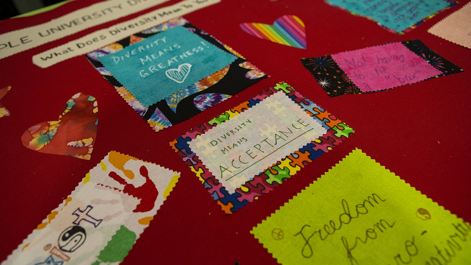 """A fabric on the diversity quilt that says """"diversity means acceptance."""""""