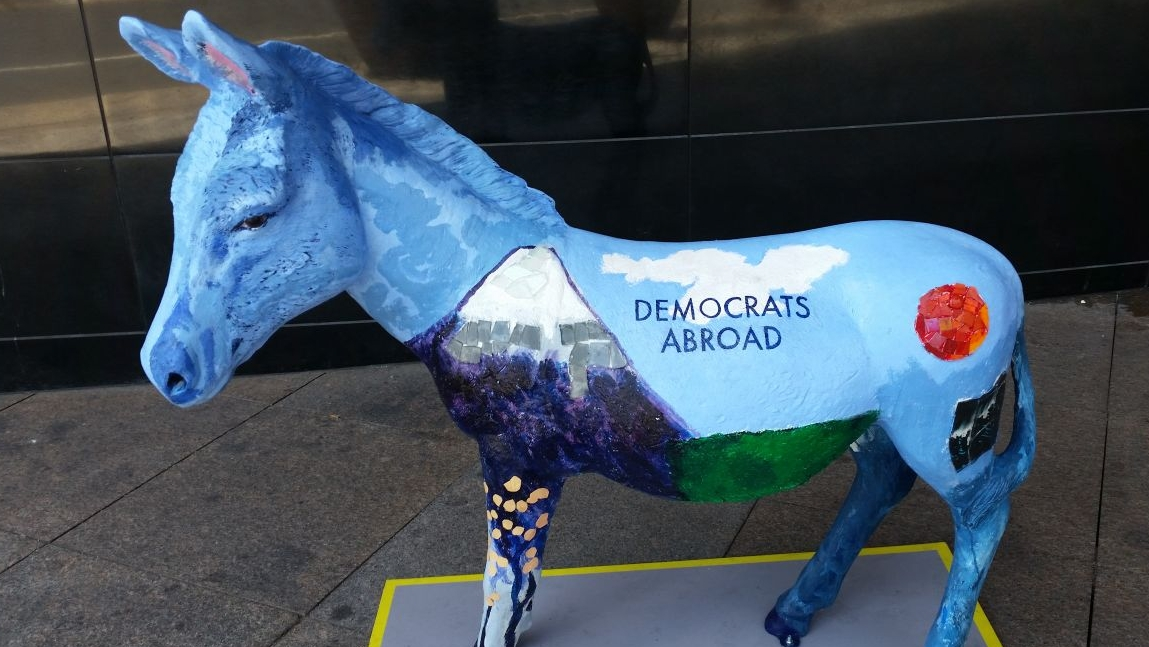A donkey painted with visual elements representing Democrats living abroad.