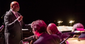 Terell Stafford conducting a jazz orchestra.