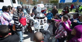 children smiling as they watch a robot at Temple Ambler EarthFest.