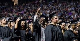 Graduates celebrating at Temple's Commencement ceremony.