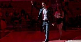 Pepe Sanchez waving as he walks across a gym.