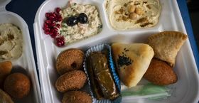 Image of Takeout containers of Syrian delicacies were distributed to guests of a virtual dinner.