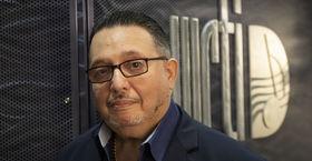 El Viaje host David Ortiz at the WRTI studio.